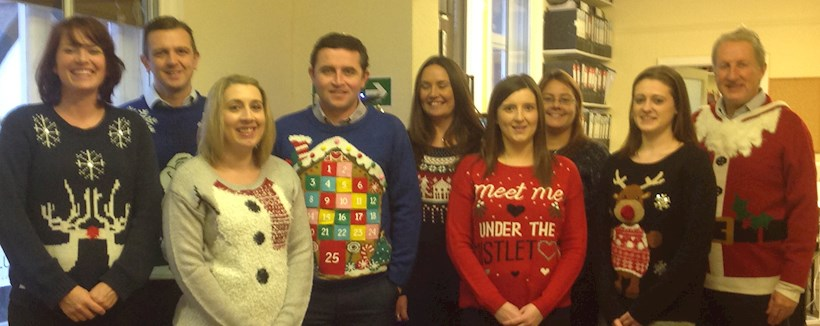 Image for Ellis & Co pull on their Christmas jumpers